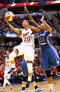 INDIANAPOLIS, IN - OCTOBER 21: Briann January #20 of the Indiana Fever shoots the ball against Seimone Augustus #33 of the Minnesota Lynx during Game Four of the 2012 WNBA Finals on October 21, 2012 at Bankers Life Fieldhouse in Indianapolis, Indiana. NOTE TO USER: User expressly acknowledges and agrees that, by downloading and or using this Photograph, user is consenting to the terms and conditions of the Getty Images License Agreement. (Photo by Michael Hickey/Getty Images) *** Local Caption *** Briann January; Seimone Augustus