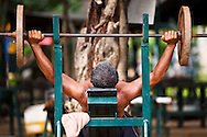 A man weightlifting at Lumpini Park in bangkok, Thailand