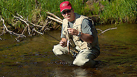 Rick with a Fish - Fly Fishing Caught and Released in Rocky Mountain National Park. Image taken with a Nikon D2xs and 80-400 mm VR lens  (ISO 100, 122 mm, f/5.6, 1/320 sec).