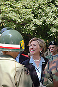 Chappaqua, NY, May 28: Hillary Clinton speaks with American Military Veterans before marching in the Memorial Day parade in her hometown of Chappaqua, New York.  Hillary Rodham Clinton was a United States Senator at the time (2006) and was Grand Marshall of the parade.