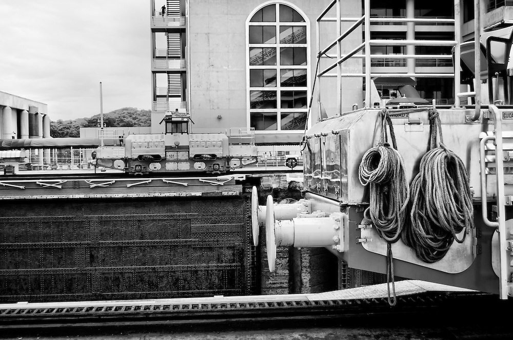MIRAFLORES LOCKS - PANAMA CANAL<br /> Photography by Aaron Sosa<br /> Panama City, Panama 2012<br /> (Copyright &copy; Aaron Sosa)<br /> <br /> The Panama Canal is an 77.1-kilometre (48 mi) ship canal in Panama that connects the Atlantic Ocean (via the Caribbean Sea) to the Pacific Ocean. The canal cuts across the Isthmus of Panama and is a key conduit for international maritime trade. There are locks at each end to lift ships up to Lake Gatun (26m (85ft) above sea-level) which was used to reduce the amount of work required for a sea-level connection. The current locks are 33.5m (110ft) wide although new larger ones are proposed.<br /> <br /> Work on the canal, which began in 1881, was completed in 1914, making it no longer necessary for ships to sail the lengthy Cape Horn route around the southernmost tip of South America (via the Drake Passage) or to navigate the dangerous waters of the Strait of Magellan. One of the largest and most difficult engineering projects ever undertaken, the Panama Canal shortcut made it possible for ships to travel between the Atlantic and Pacific Oceans in half the time previously required. The shorter, faster, safer route to the U.S. West Coast and to nations in and along the Pacific Ocean allowed those places to become more integrated with the world economy.