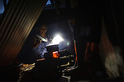 Many residents of Yolonda Village remain without electricity nearly six months after typhoon Haiyan made landfall, and rely on rechargable LED lights to see at night.
