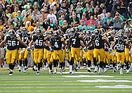 September 24, 2011: Iowa Hawkeyes wide receiver Marvin McNutt (7), Iowa Hawkeyes wide receiver Keenan Davis (6) and the rest of the team run onto the field before the start of the game between the Iowa Hawkeyes and the Louisiana Monroe Warhawks at Kinnick Stadium in Iowa City, Iowa on Saturday, September 24, 2011. Iowa defeated Louisiana Monroe 45-17.