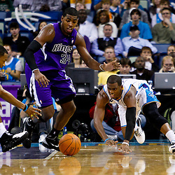 December 15, 2010; Sacramento Kings center Jason Thompson (34) and New Orleans Hornets point guard Chris Paul (3) and shooting guard Willie Green (33) scramble for a loose ball during the second half at the New Orleans Arena. The Hornets defeated the Kings 94-91. Mandatory Credit: Derick E. Hingle