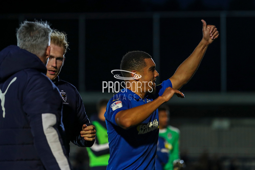 AFC Wimbledon striker Kweshi Appiah (9) giving a thumbs up after walking off pitch during the EFL Sky Bet League 1 match between AFC Wimbledon and Lincoln City at the Cherry Red Records Stadium, Kingston, England on 2 November 2019.
