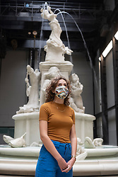"© Licensed to London News Pictures. 24/07/2020. London, UK. A Tate staff member wearing a face mask poses next to ""Fons Americanus"", 2019, by Kara Walker. , at the Tate Modern art museum. The Tate Modern will re-open to the public after closing due to the Coronavirus outbreak. Photo credit: Ray Tang/LNP"