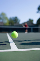 tennis ball bouncing off the line and into the net on a tennis court action