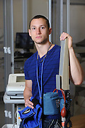 A student in Kent State's physical therapy program, housed at the East Liverpool campus, poses in one of the labs on campus.