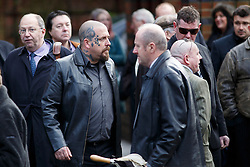 © licensed to London News Pictures. London, UK 03/01/2014. Mourners attending to the funeral of Great Train Robber Ronnie Biggs at Golders Green crematorium in north London. Biggs died on December 18, 2013 aged 84 after famously spent 35 years on the run from prison. Photo credit: Tolga Akmen/LNP