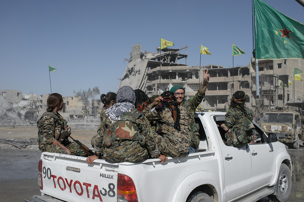 After Raqqa was liberated from ISIS, British YPJ volunteer Kimmi Taylor drives together with other female fighters across al-Naim Square in Raqqa, Syria, October 18, 2017