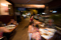 Diners enjoy traditional Thai cuisine on the footpath out the front of the Siam Thai Restaurant in Port Douglas, far north Queensland, Australia.