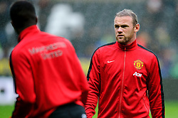 Man Utd Forward Wayne Rooney (ENG) looks at Man Utd Forward Wilfried Zaha (ENG) before the match - Photo mandatory by-line: Rogan Thomson/JMP - Tel: Mobile: 07966 386802 17/08/2013 - SPORT - FOOTBALL - Liberty Stadium, Swansea -  Swansea City V Manchester United - Barclays Premier League - First round of the 2013/14 season and the first league match for new Man Utd manager David Moyes.