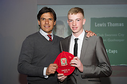 CARDIFF, WALES - Saturday, May 11, 2013: Lewis Thomas is presented with his U16's cap by Wales national team manager Chris Coleman at the FAW Trust Under-16's cap presentation. (Pic by David Rawcliffe/Propaganda)