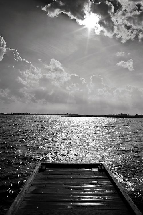 Black and white image of the dock at refuge headquarters overlooking Back Bay just after a thunderstorm, Back Bay National Wildlife Refuge, Virginia Beach, Virginia.