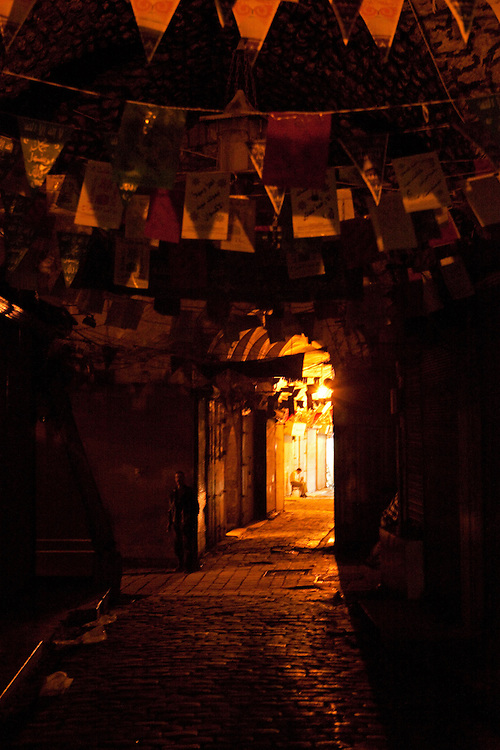Ancient shadows of the souq / market at night, Aleppo, Syria