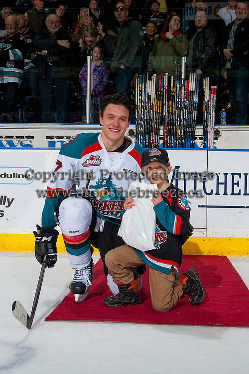 KELOWNA, CANADA - FEBRUARY 13: Calvin Thurkauf #27 of the Kelowna Rockets accepts the first star of the game against the Seattle Thunderbirds on February 13, 2017 at Prospera Place in Kelowna, British Columbia, Canada.  (Photo by Marissa Baecker/Shoot the Breeze)  *** Local Caption ***