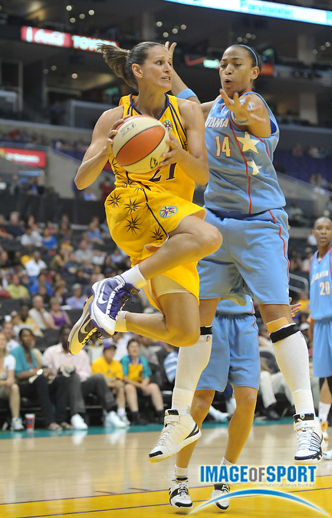 May 30, 2010; Los Angeles, CA, USA; Los Angeles Sparks guard Ticha Penicheiro (21) is defended by Atlanta Dream forward Erika De Souza (14) in the first half at the Staples Center.