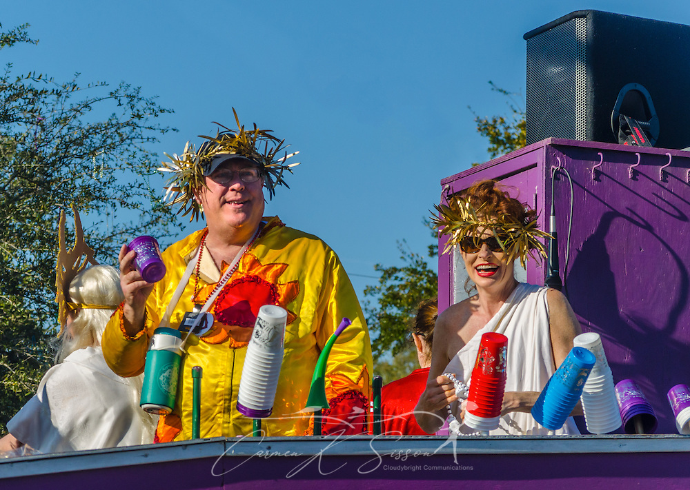 Revelers throw trinkets to the crowd as their float travels down Canal Street in downtown Mobile, Ala., during the Joe Cain Procession at Mardi Gras, March 2, 2014. French settlers held the first Mardi Gras in 1703, making Mobile's celebration the oldest Mardi Gras in the United States. (Photo by Carmen K. Sisson/Cloudybright)