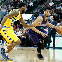 04 March 2017: Charlotte Hornets guard Jeremy Lamb (3) drives past `Denver Nuggets guard Will Barton (5) during the Charlotte Hornets 112-102 victory over the Denver Nuggets, at the Pepsi Center, Denver, Colorado, USA.