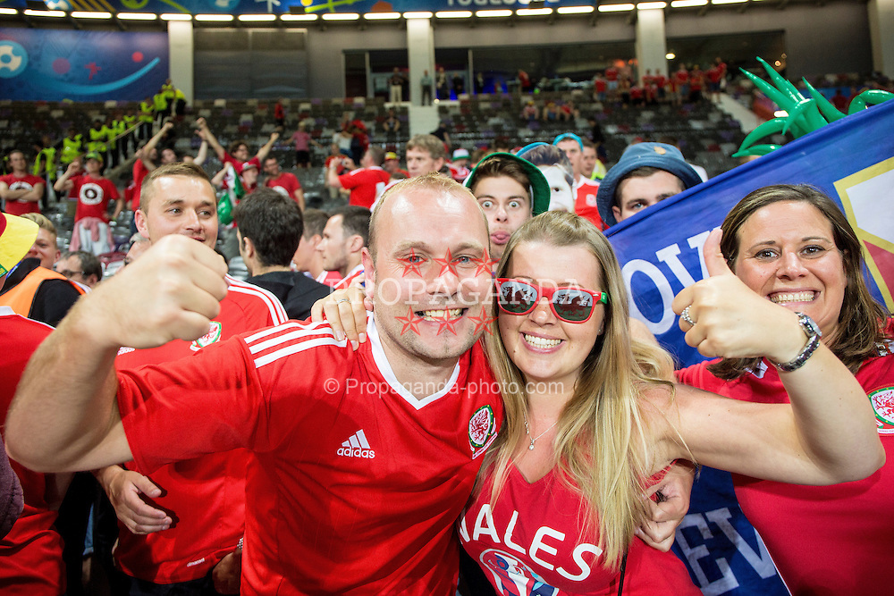 TOULOUSE, FRANCE - Monday, June 20, 2016: Wales supporters celebrate the 3-0 victory and Wales' progression into the knockout stages after the final Group B UEFA Euro 2016 Championship match against Russia at Stadium de Toulouse. (Pic by Paul Greenwood/Propaganda)