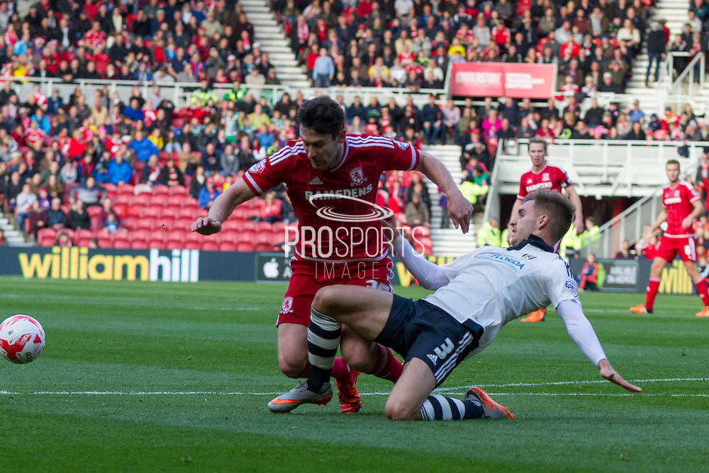 Fulham defender Luke Garbutt clears the ball from the feet of \Middlesbrough FC striker David Nugent during the Sky Bet Championship match between Middlesbrough and Fulham at the Riverside Stadium, Middlesbrough, England on 17 October 2015. Photo by George Ledger.