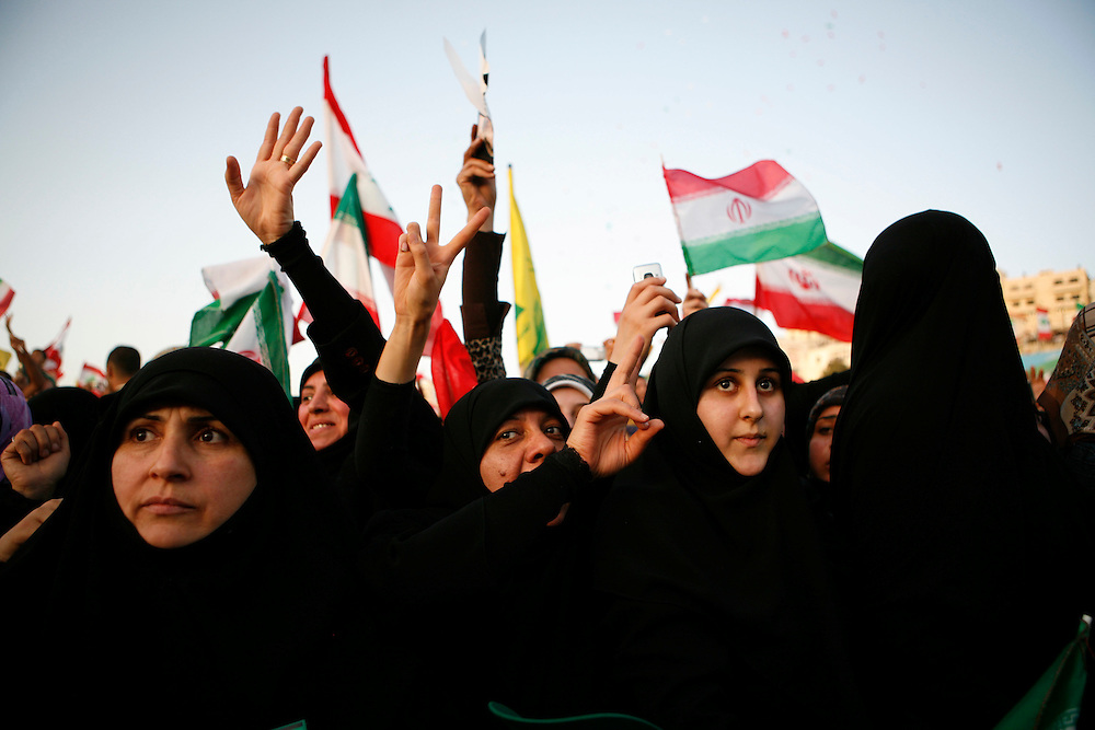 On the second and final day of his visit to Lebanon, Iranian President Mahmoud Ahmadinejad traveled to the southern town of Bint Jbeil. There a Hizballah-organized rally was held to welcome Ahmadinejad to the south Lebanon, an area where Hizballah is widely supported. Tens of thousands gathered for hours holding flags of Iran, Hizballah, Lebanon and other political parties, cheering the Iranian president as he arrived by helicopter from Beirut. ///People rally at a stadium in Bint Jbeil while Iranian President Mahmoud Ahmadinejad addresses the crowd.