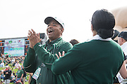 Ohio Univeristy President, Roderick McDavis, cheers as the Bobcats make an interception during their homecoming matchup against Bowling Green at Peden Stadium in Athens, Ohio on Saturday, October 8, 2016.