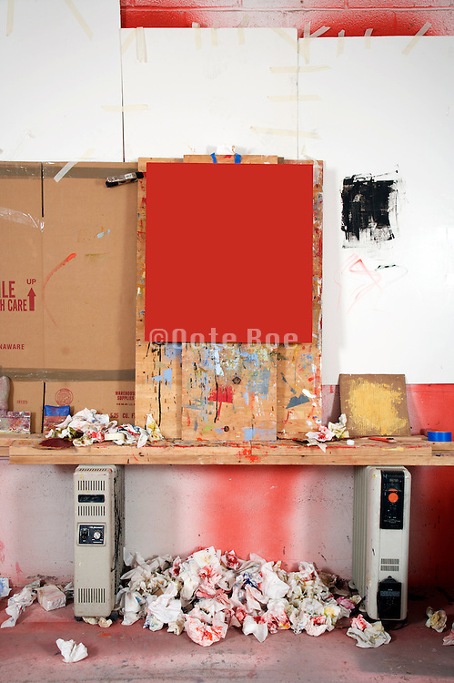 studio of artist with red canvas on improvised easel