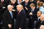 President Donald Trump congratulates his Vice President Mike Pence following his Inaugural address after being sworn-in as the 45th President on Capitol Hill January 20, 2017 in Washington, DC.