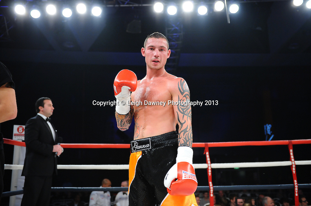 Garry Neale poses for the press after defeating Simas Volosinas in a Light Welter weight contest. Glow, Bluewater, Kent, UK. Hennessy Sports © Leigh Dawney Photography 2013.