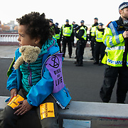 Thousands of Extinction Rebellion activists took over 5 bridges in Central London and blocked them for the day, November 17 2018, Central London, United Kingdom. Blackfriars Bridge; a peacefull occupation of the bridge begins. Around 11am people on all bridges sat down in the road and blocked traffic from coming through and stayed till late afternoon. The actvists believe that the government is not doing enough to avoid catastrophic climate change and they demand the government take radical action to save future generations and the planet. Many are willing to be arrested peacefully protesting and up to 80 were arrested on the day. Extinction Rebellion is a grass root climate change group started in 2018 and has gained a huge following of people commited to peaceful protests and who ready to be arrested. Their major concern is that the world is facing catastropohic climate change and they want the British government to act now to save future generations.