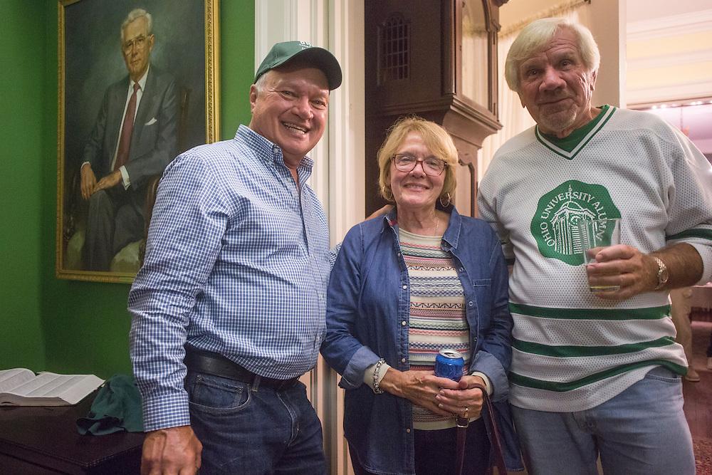 Tom Gosiorowski, left, Jane Carlson, middle, and Joe Zieleniewski pose for a photo during the 1960s hockey alumni reunion at the Konneker Alumni House on September 30, 2016.