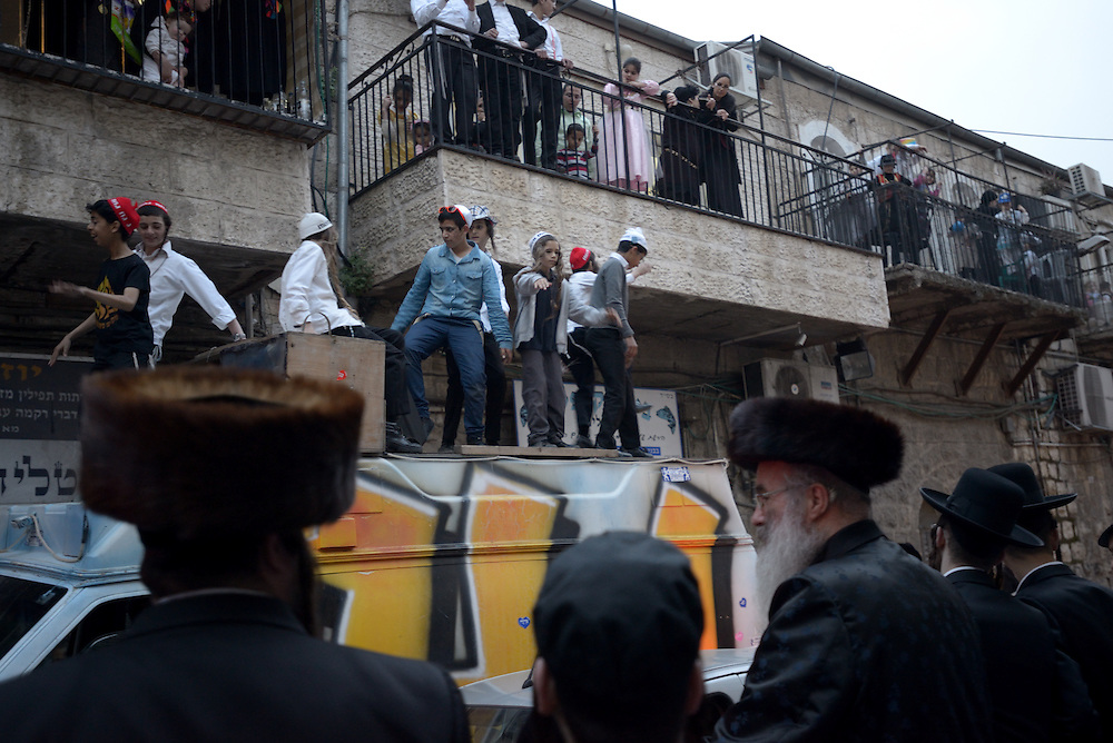 JERUSALEM, ISRAEL - MARCH 17, 2014: Ultra-Orthodox Jewish people celebrate the Purim holiday in the ultra-orthodox Mea Shearim neighborhood in Jerusalem on March 17, 2014. The festival of Purim commemorates the rescue of Jews from a genocide in ancient Persia. Photo by Gili Yaari