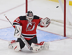 Oct 15; Newark, NJ, USA; Colorado Avalanche right wing Chris Stewart (25) scores a goal on New Jersey Devils goalie Martin Brodeur (30) during the third period at the Prudential Center. The Avalanche defeated the Devils 3-2.