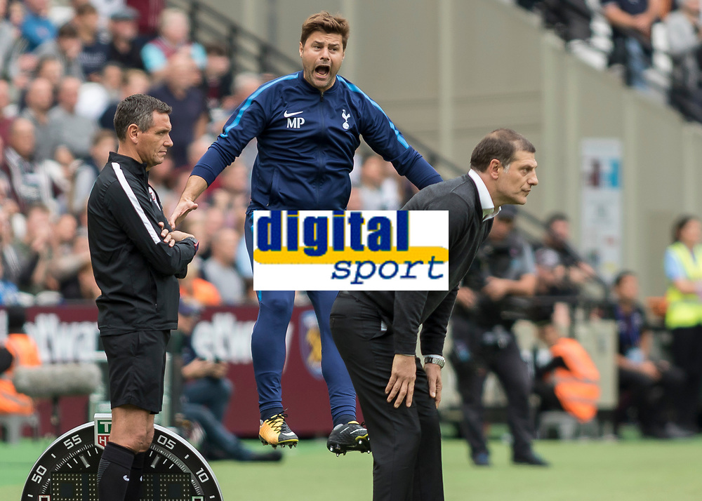 Football - 2017 / 2018 Premier League - West Ham United vs Tottenham Hotspur<br /> <br /> Mauricio Pochettino, Manager of Tottenham FC, leaps into the incensed at foul made on one of his players at the London Stadium<br /> <br /> COLORSPORT/DANIEL BEARHAM