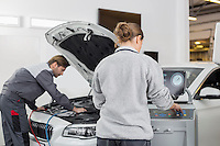 Automobile mechanics working in automobile repair shop
