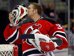 March 7, 2008; Newark, NJ, USA; New Jersey Devils goalie Martin Brodeur (30) kisses the initials of his children on the back of his mask before the first period at the Prudential Center in Newark, NJ.