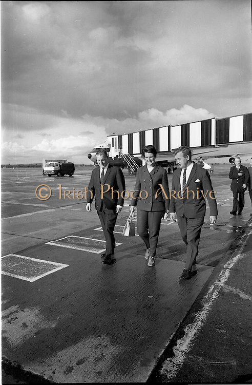 0/09/1967<br /> 09/20/1967<br /> 20 September 1967<br /> Mr Charles Haughey T.D., Minister for Finance, departs for the United States of America from Dublin Airport. Mr Haughey was to open New Ireland House in New York before traveling on to Rio de Janeiro, to attend the World Bank and International Monetary Fund meeting. Picture shows (l-r): Mr Charles Haughey TD; Mrs Maureen Haughey and Mr Finbarr Donovan, Aer Lingus Assistant General Manager Commercial, walking to the aircraft.