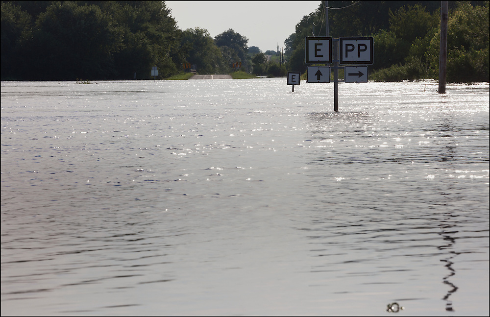 Excessive rain water runoff  from Northern Missouri has Highway E and Highway PP underwater creating creek and river flooding near Carrollton, MO.