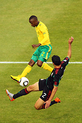 South Africa's Siboniso Gaxa vs  Mexico's Francisco Rodriguez during the Group A first round 2010 FIFA World Cup South Africa match between South Africa and Mexico at Soccer City Stadium on June 11, 2010 in Johannesburg, South Africa.  (Photo by Vid Ponikvar / Sportida)