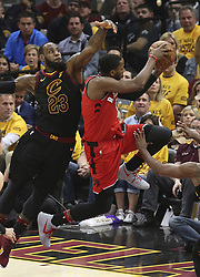 May 7, 2018 - Cleveland, OH, USA - Cleveland Cavaliers' LeBron James defends a second quarter shot inside by Toronto Raptors' C.J. Miles in Game 4 of a second-round playoff series on Monday, May 7, 2018 in Cleveland, Ohio. (Credit Image: © Phil Masturzo/TNS via ZUMA Wire)