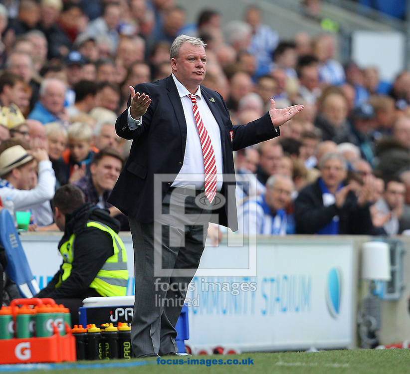 Steve Evans, Manager of Rotherham United during the Sky Bet Championship match at the American Express Community Stadium, Brighton and Hove<br /> Picture by Paul Terry/Focus Images Ltd +44 7545 642257<br /> 25/10/2014