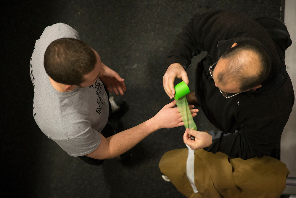 George Mason defenseman, Matt Rodriguez, has is wrist taped by a team trainer before playing host to Northern Virginia Community College on senior night at Prince William Ice Rink in Woodbridge, VA on January 31, 2014.