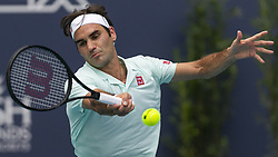 March 25, 2019 - Miami Gardens, FL, USA - oger Federer, of Switzerland, returns a shot to Filip Krajinovic, of Serbia, during their match at the Miami Open tennis tournament on Monday, March 25, 2019 at Hard Rock Stadium in Miami Gardens, Fla. (Credit Image: © Matias J. Ocner/Miami Herald/TNS via ZUMA Wire)