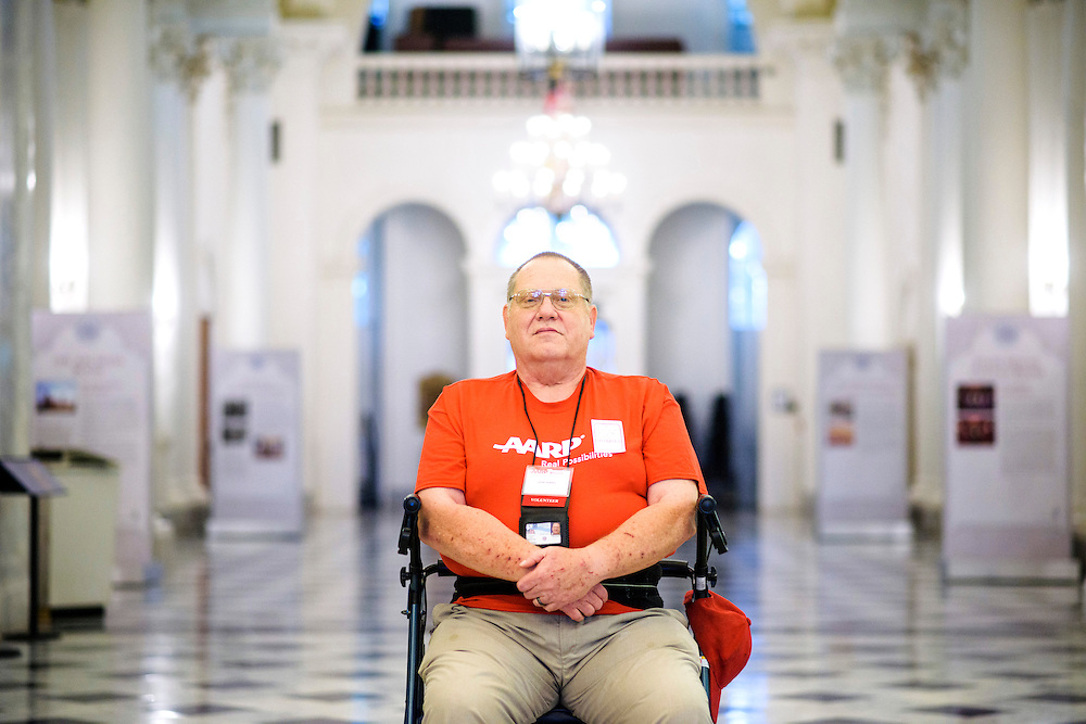 Annapolis, Maryland - May 21, 2015: John Hankel, from Baltimore, is photographed in the Maryland Statehouse Thursday May 21, 2015. Hankel, 61, is a wounded veteran from the Vietnam War era who uses Maryland's Medicaid services. He works with AARP to train fellow legislative advocates on how to talk to Maryland law makers about reinstitution the CARE act.<br /> <br /> <br /> CREDIT: Matt Roth