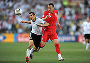 Miroslav KLOSE  and John TERRY (re, England) during the 2010 World Cup Soccer match between England and Germany in a group 16 match played at the Freestate Stadium in Bloemfontein South Africa on 27 June 2010.