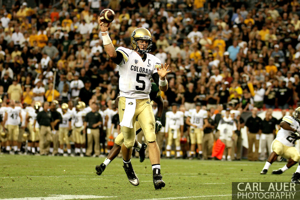 September 1st, 2013 - Colorado Buffaloes junior quarterback Connor Wood (5) passes for a two point conversion in the fourth quarter of the NCAA football game between the Colorado Buffaloes and the Colorado State Rams at Sports Authority Field in Denver, CO