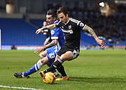 Brentford midfielder Sam Saunders evades the challenge of Brighton defender Liam Ridgewell (33) during the Sky Bet Championship match between Brighton and Hove Albion and Brentford at the American Express Community Stadium, Brighton and Hove, England on 5 February 2016. Photo by David Charbit.