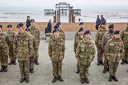 © Licensed to London News Pictures. 11/11/2017. Brighton, UK. Military personnel and veterans join Army cadet's on a British Airways i360 flight above Brighton and Hove. A two minute silence is held at the top of the tower to commemorate Armistice Day. Photo credit: Hugo Michiels/LNP
