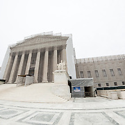 Scaffolding and a image scrim (photo on a mesh covering the scaffolding) cover the U.S. Supreme Court as the building undergoes renovations.